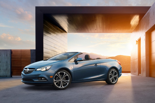 Buick Cascada Convertible, still ¾ front angle with roof down. Vehicle is shown in Deep Sky Metallic exterior color, ebony leather interior and 20-inch wheels © General Motors