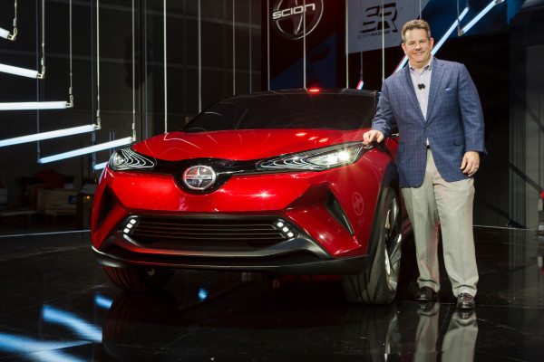Scion Vice President Andrew Gilleland reveals the Scion C-HR Concept vehicle during the Los Angeles Auto Show © Toyota Motor Corporation