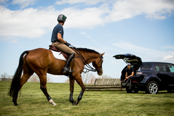 Will Coleman, USA Equestrian Event Rider rides Butch Cassidy with his 2016 Land Rover Discovery Sport in background © Tata Group