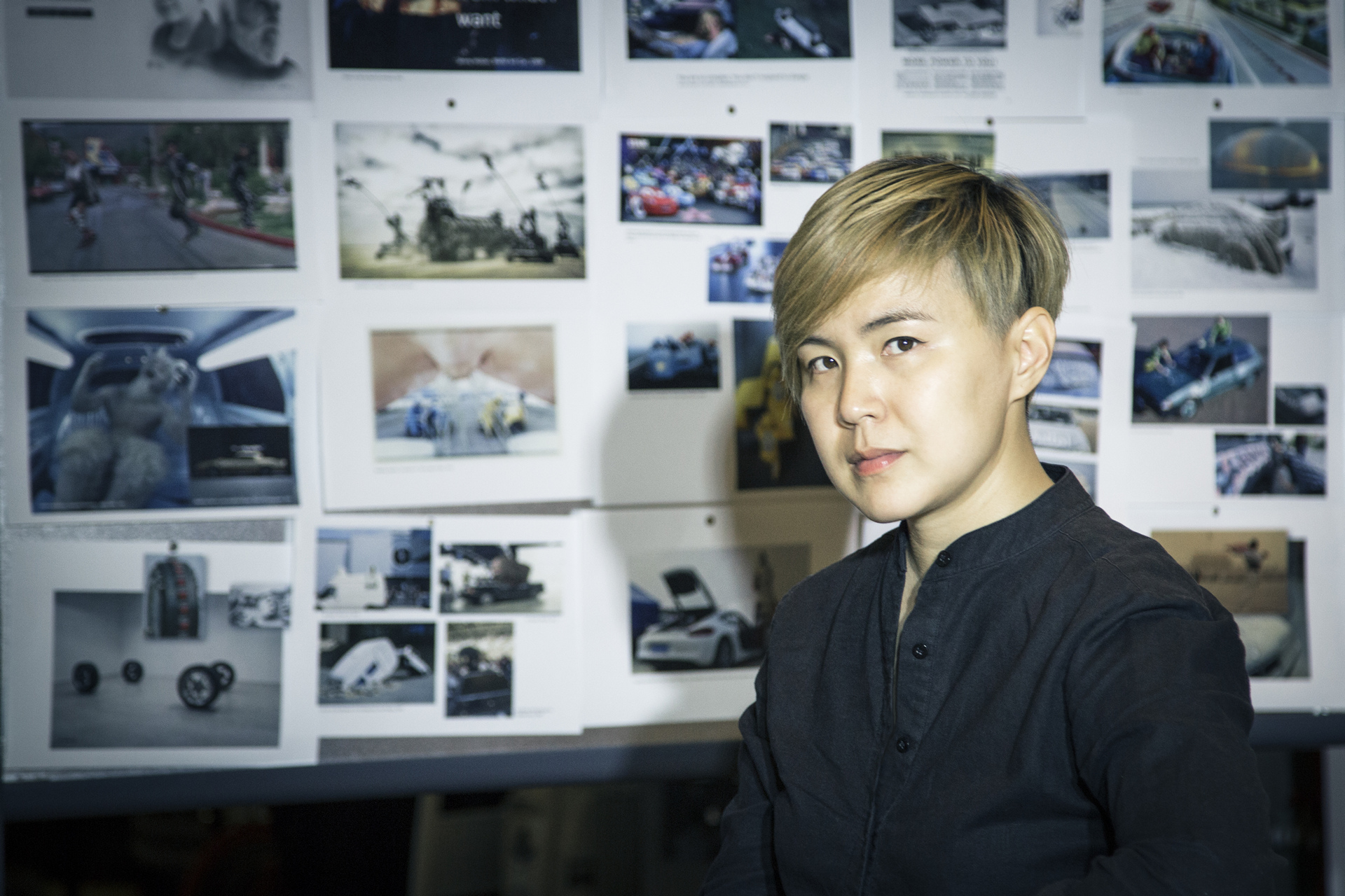 The artist Cao Fei in front of her inspiration wall for the 18th BMW Art Car project © BMW AG