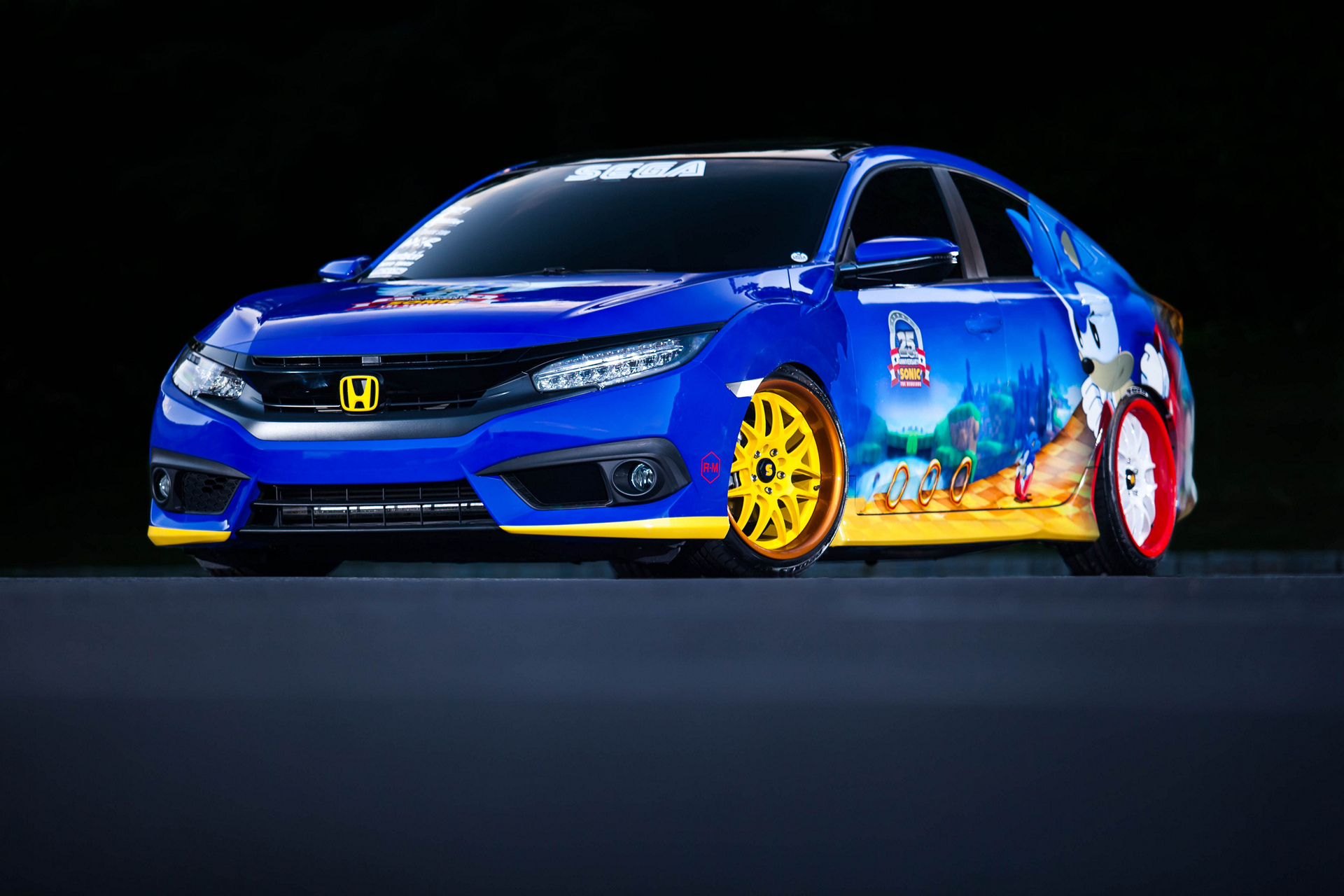 "Honda Debuts Custom-Designed ""Sonic Civic"" at Comic-Con; Joins ""Sonic the Hedgehog™"" and SEGA® in Celebrating the Iconic Game's 25th Anniversary © Honda Motor Co., Ltd.Honda Debuts Custom-Designed ""Sonic Civic"" at Comic-Con; Joins ""Sonic the Hedgehog™"" and SEGA® in Celebrating the Iconic Game's 25th Anniversary © Honda Motor Co., Ltd."